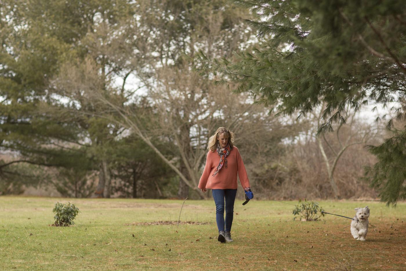 Faith walks outside.