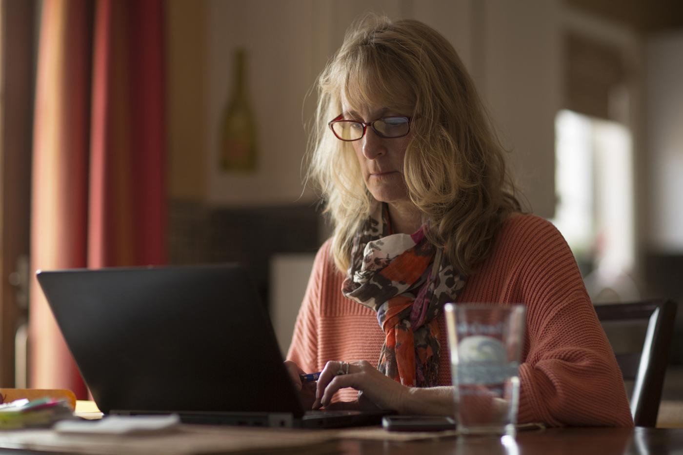 Faith works on her laptop.