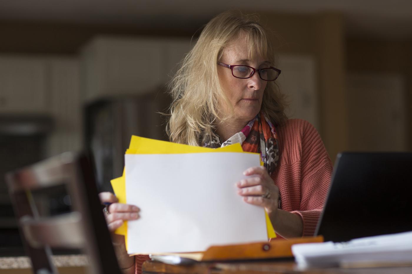 Faith organizes her paperwork.