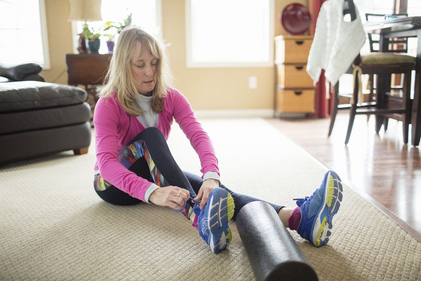 Faith ties the laces on her running shoes.