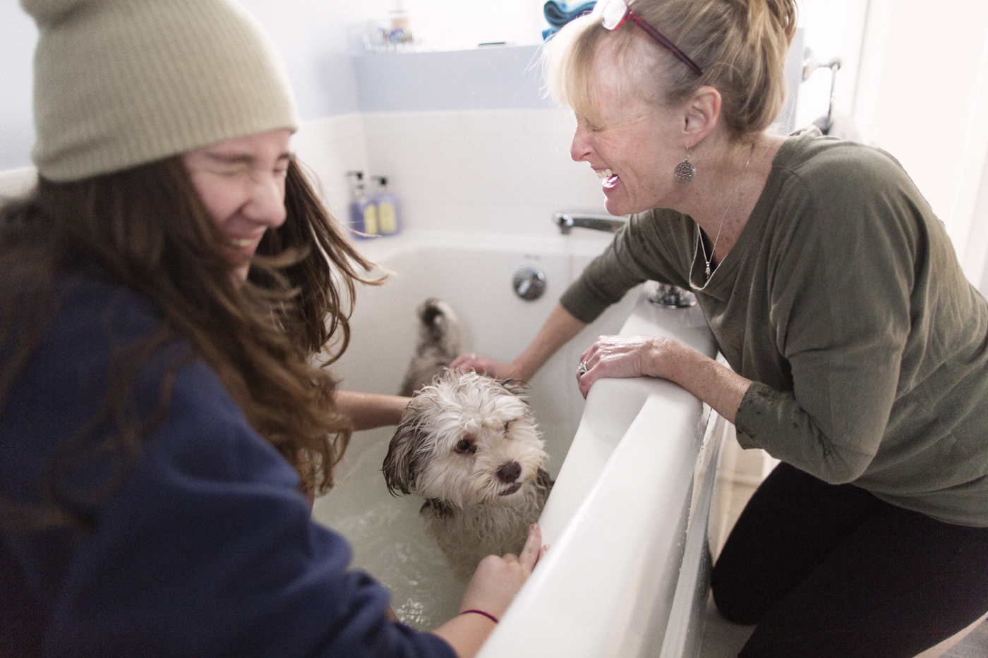 Faith and her daughter get sprayed as their dog shakes itself dry.
