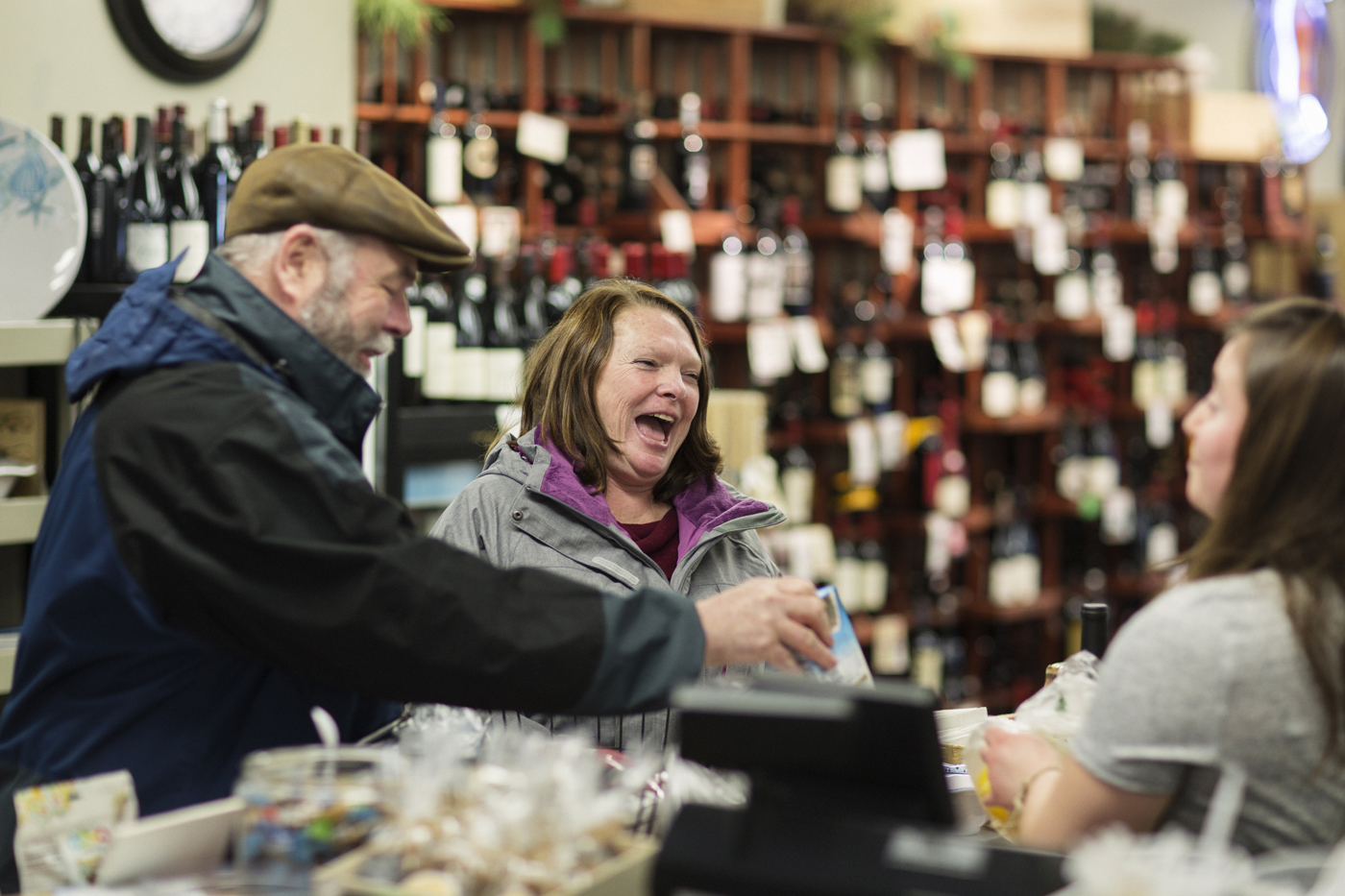 Ramona and her husband chat with a clerk at a liquor store.