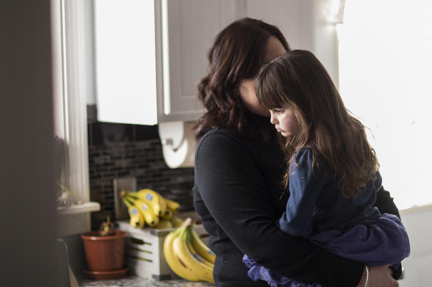 Violet's mom holds Violet