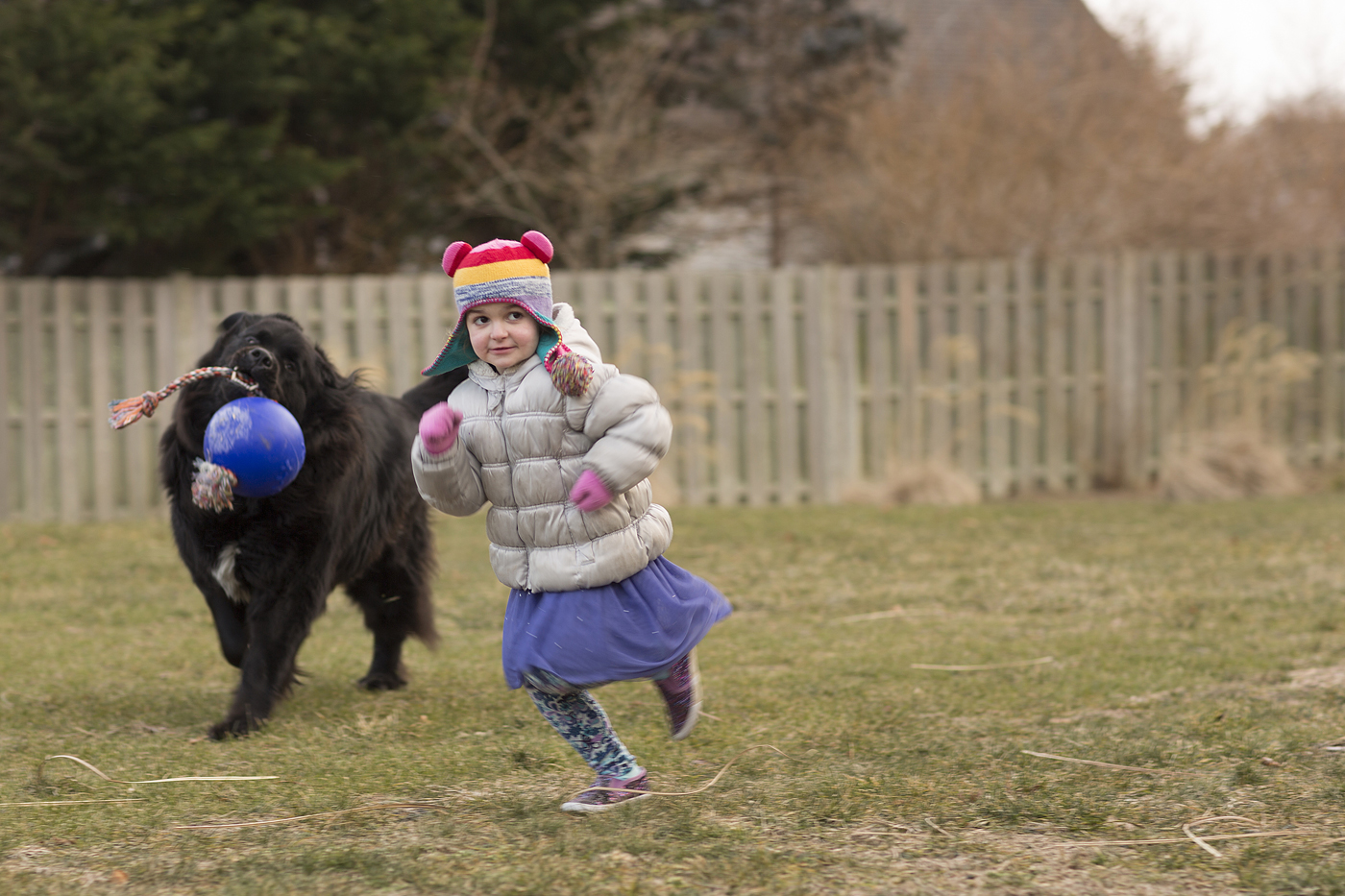 Violet runs with her dog.