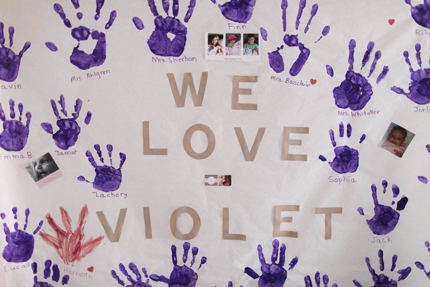"""A sign states """"We love Violet."""""""