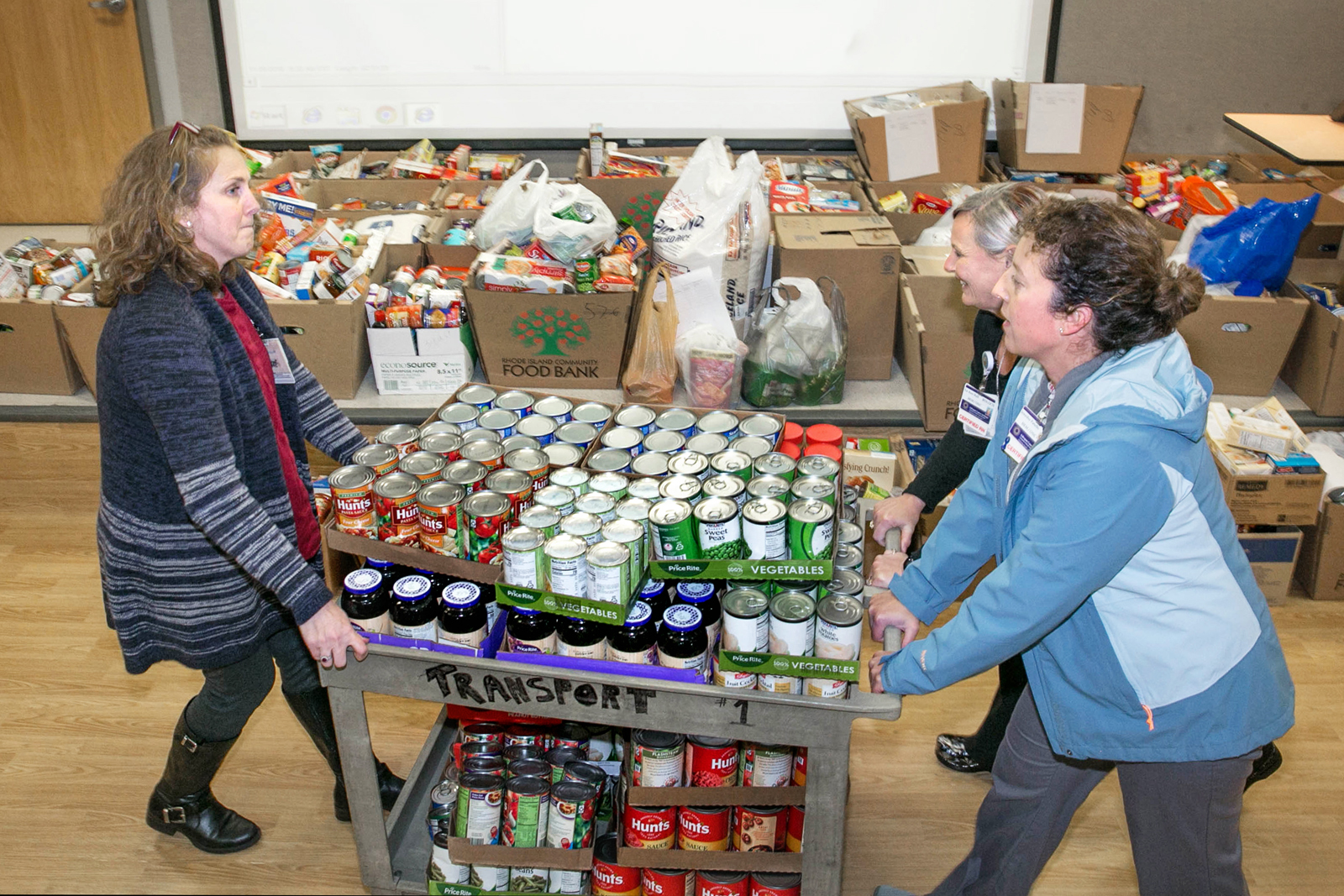 Photo of staff with donated food