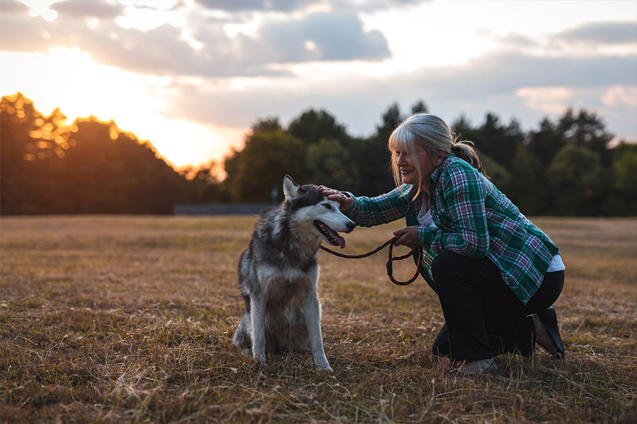 happy older woman with dog