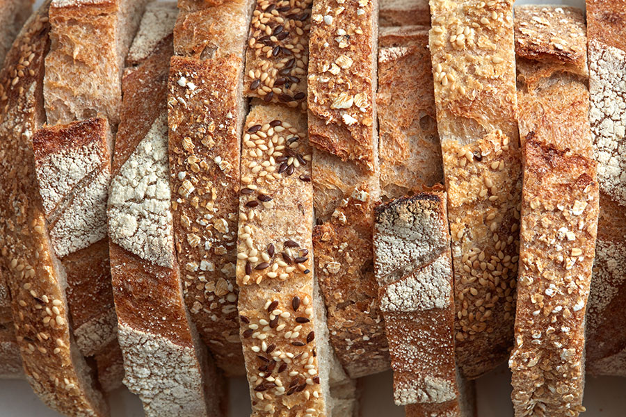 Gluten is a protein typically found in wheat, barley, and rye which are common in most breads.