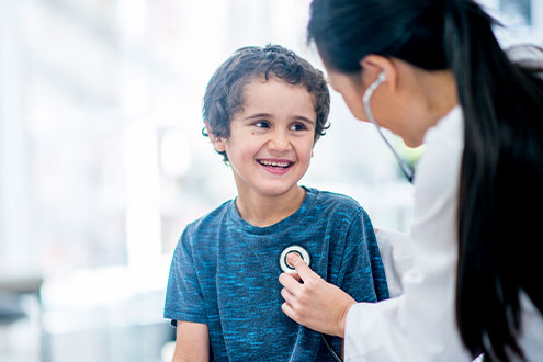 A child is examined by a doctor.