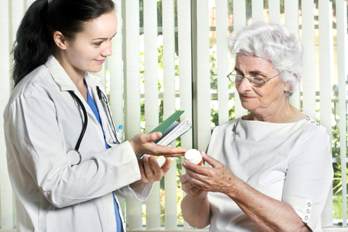 A Lifespan pharmacist reviews medication with a patient