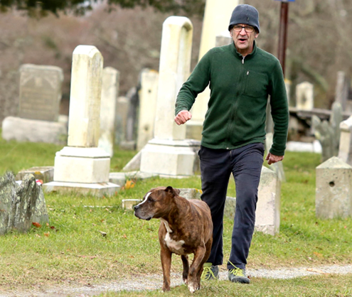 Doug walks his dog in Newport's old burial ground