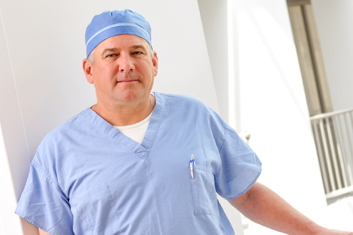 Rolf Langeland, MD in scrubs at Newport Hospital.