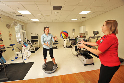 Physical Therapist helps patient regain strength and balance