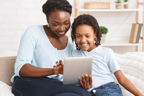 Mom and daughter having a remote visit using a tablet