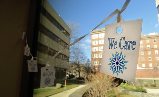 We Care sign hanging from a window