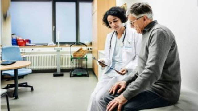 Doctor and patient sitting and talking