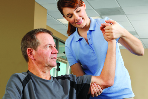 patient undergoing shoulder and elbow rehab at the Total Joint Center