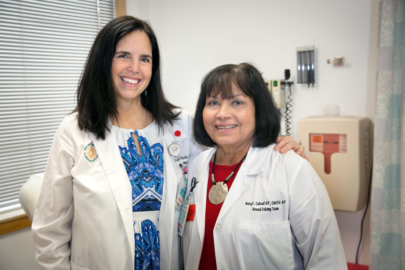 Erin DellaGrotta, RN, left, and Mary Cabral, CNP, right, care for patients at the Ostomy Center